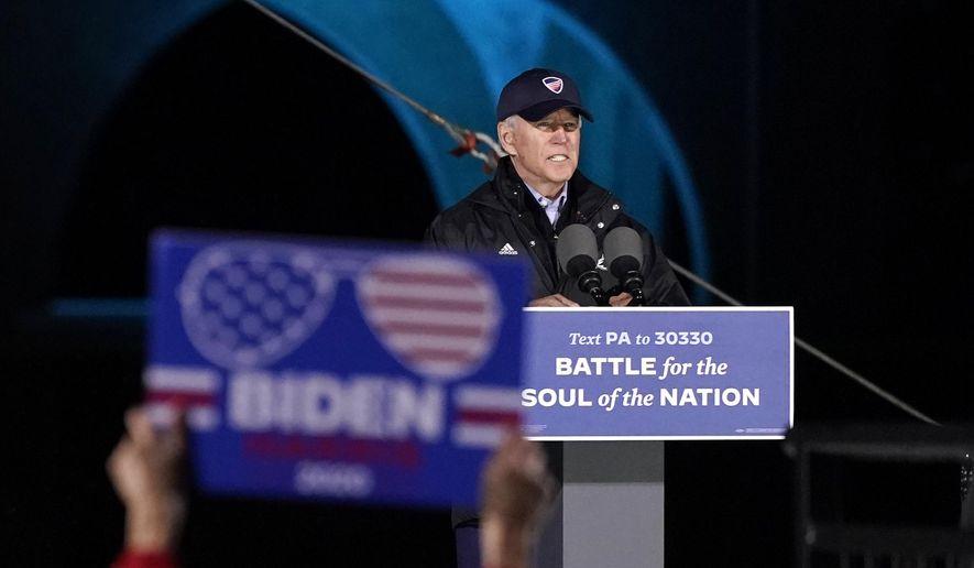Democratic presidential candidate former Vice President Joe Biden speaks at a drive-in rally at Franklin Delano Roosevelt Park, Sunday, Nov. 1, 2020, in Philadelphia. (AP Photo/Andrew Harnik)