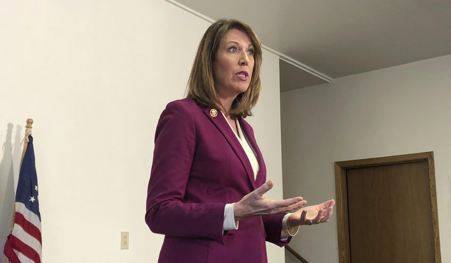In this Saturday, Dec. 21, 2019, photo, Rep. Cindy Axne, D-Iowa., speaks to constituents about her vote on the USMCA trade deal in Guthrie Center, Iowa. (AP Photo/Alexandra Jaffe) **FILE**