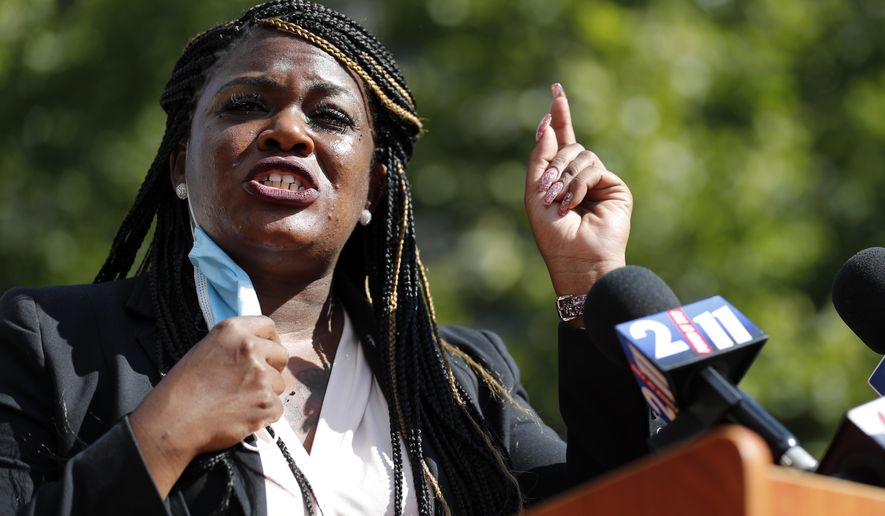 In this Aug. 5, 2020, file photo, Activist Cori Bush speaks during a news conference Wednesday, Aug. 5, 2020, in St. Louis. Bush is a racial justice activist running for Missouri's 1st Congressional seat in the Nov. 3, 2020, general election. (AP Photo/Jeff Roberson, File)