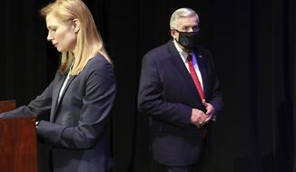 FILE - In this Oct. 9, 2020, file photo, Missouri gubernatorial candidates, Gov. Mike Parson, and State Auditor Nicole Galloway are seen onstage before the Missouri gubernatorial debate at the Missouri Theatre in Columbia, Missouri. They are opposing each other in the Nov. 3, 2020, general election. (Robert Cohen/St. Louis Post-Dispatch via AP, Pool File)