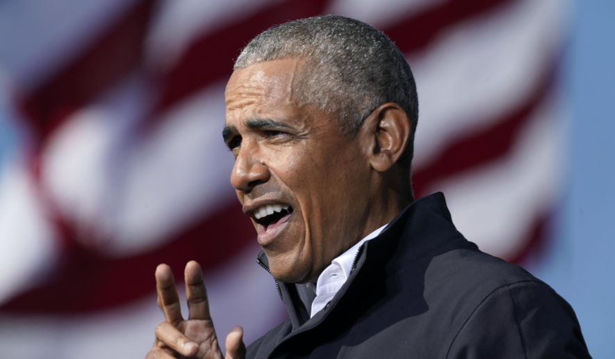 Former President Barack Obama speaks at a rally as he campaigns for Democratic presidential candidate former Vice President Joe Biden, Monday, Nov. 2, 2020, at Turner Field in Atlanta. (AP Photo/Brynn Anderson)