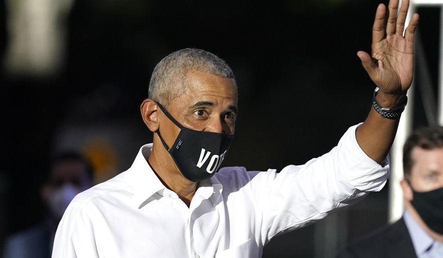 Former President Barack Obama waves as he arrives for a campaign rally for Democratic presidential candidate former Vice President Joe Biden, Monday, Nov. 2, 2020, in Miami. (AP Photo/Lynne Sladky)