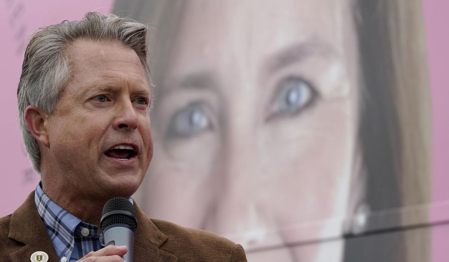 FILE - In this Oct. 21, 2020, file photo, U.S. Rep. Roger Marshall, R-Kan., Republican candidate for U.S. Senate, speaks in front of photo of Supreme Court nominee Amy Coney Barrett at a campaign stop in Kansas City, Kan. (AP Photo/Charlie Riedel, File)