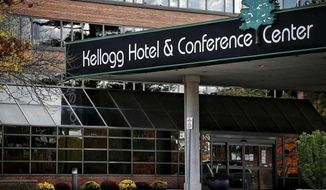 The Kellogg Hotel and Conference Center pictured on the Michigan State University campus, Friday, Oct. 16, 2020, in East Lansing, Mich. Any on-campus students not living in single-occupancy rooms with their own bathrooms are asked to self-isolate at Kellogg Center if they contract COVID-19 or have been exposed to someone who did. (Nick King/Lansing State Journal via AP)