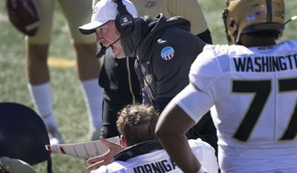 Purdue head coach Jeff Brohm yells at his offensive linemen during the second half of an NCAA college football game against Illinois Saturday, Oct. 31, 2020, in Champaign, Ill. (AP Photo/Charles Rex Arbogast)