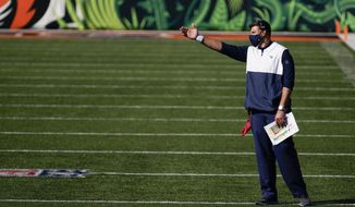 Tennessee Titans head coach Mike Vrabel questions a call during the first half of an NFL football game against the Cincinnati Bengals, Sunday, Nov. 1, 2020, in Cincinnati. (AP Photo/Bryan Woolston)