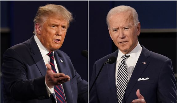 Then-President Donald Trump and former Vice President Joe Biden during the first presidential debate at Case Western University and Cleveland Clinic, in Cleveland, Ohio. (AP Photo/Patrick Semansky, File)
