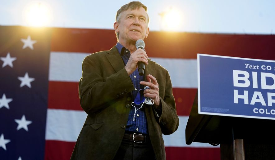 FILE—John Hickenlooper, Democratic candidate for the U.S. Senate seat in Colorado, speaks during a car rally for Doug Emhoff, husband of Democratic vice presidential candidate Kamala Harris, at East High School late Thursday, Oct. 8, 2020, in Denver. More than 70 motorists took part in the rally to urge people to get out and vote in the upcoming election. (AP Photo/David Zalubowski, File)
