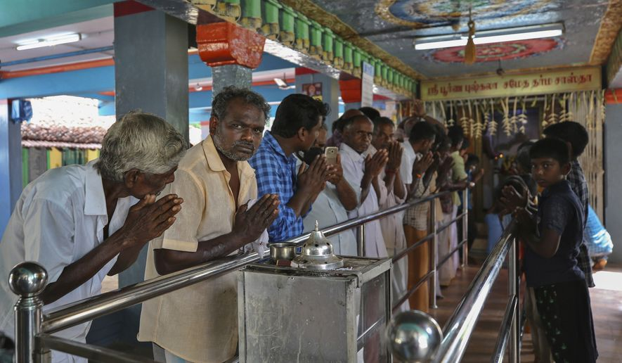 Hindu devotees participate in a special prayer performed for the success of U.S. democratic vice presidential candidate Sen. Kamala Harris, at a temple in Thulasendrapuram village, south of Chennai, Tamil Nadu state, India, Tuesday, Nov. 3, 2020. The lush green village is the hometown of Harris' maternal grandfather who migrated from there decades ago. (AP Photo/Aijaz Rahi)