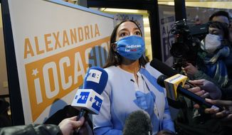 U.S. Rep. Alexandria Ocasio-Cortez, D-N.Y., speaks to the meida after addressing members of her staff and volunteers who helped with her campaign plus getting out the vote, Tuesday, Nov. 3, 2020, outside her office in the Bronx borough of New York. (AP Photo/Kathy Willens)