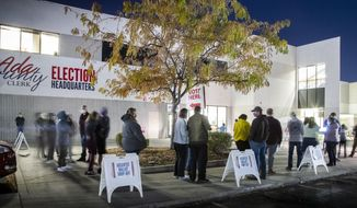 With about an hour before polls close, voters wait in a long line at Boise precinct 1701 at the Ada County Election Headquarters Tuesday, Nov. 3, 2020 in Boise. (Darin Oswald/Idaho Statesman via AP)
