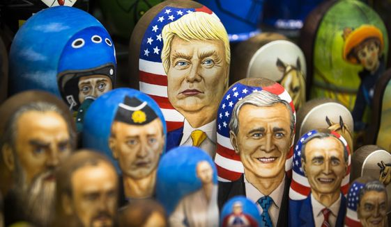 """In this photo taken on Thursday, March 2, 2017, Matryoshkas, traditional Russian wooden dolls, including a doll of U.S. President Donald Trump, top, are displayed for sale in Moscow, Russia. From Moscow, the U.S. election looks like a contest between """"who dislikes Russia most,"""" according to Kremlin spokesman Dmitry Peskov. Russian President Vladimir Putin is frustrated with President Donald Trump's failure to deliver on his promise to fix ties between the countries. But Democratic challenger Joe Biden does not offer the Kremlin much hope either. (AP Photo/Alexander Zemlianichenko, File)"""