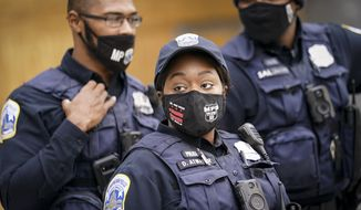 District of Columbia Metropolitan Police officers patrol outside the White House as demonstrators gather, Tuesday, Nov. 3, 2020, in Washington. (AP Photo/John Minchillo) **FILE**