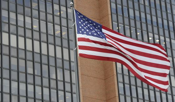 The American flag is seen at the James A. Byrne United States Courthouse, Tuesday, Nov. 3, 2020, in Philadelphia. (AP Photo/Michael Perez)