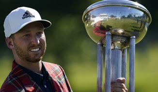 In this June 14, 2020, file photo, Daniel Berger poses with the championship trophy after winning the Charles Schwab Challenge golf tournament after a playoff round at the Colonial Country Club in Fort Worth, Texas. Even though he's No. 13 in the world, Berger has to wait until April to play in the Masters. (AP Photo/David J. Phillip, File)  **FILE**