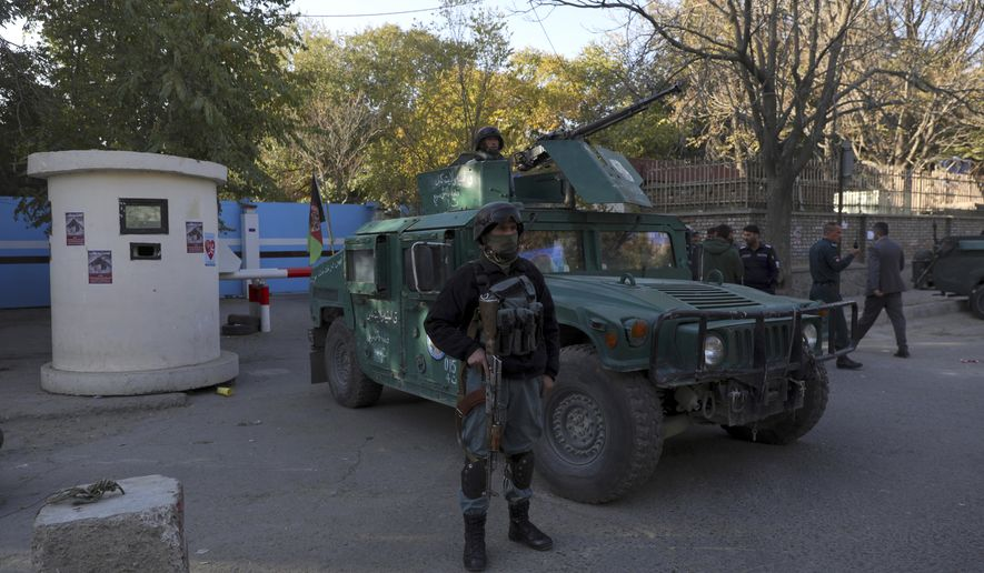 Afghan security police stand guard at the entrance gate of Kabul University after a deadly attack in Kabul, Afghanistan, Tuesday, Nov. 3, 2020. The brazen attack by gunmen who stormed the university has left many dead and wounded in the Afghan capital. The assault sparked an hours-long gun battle. (AP Photo/Rahmat Gul)