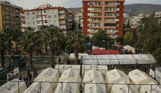 Tents set up for homeless people are placed on a basketball court in Izmir, Turkey, Monday, Nov. 2, 2020. Rescue teams continue ploughing through concrete blocs and debris of collapsed buildings in Turkey's third largest city in search of survivors of a powerful earthquake that struck Turkey's Aegean coast and north of the Greek island of Samos, Friday Oct. 30, killing dozens. Close to a thousand people were injured.(AP Photo/Emrah Gurel)