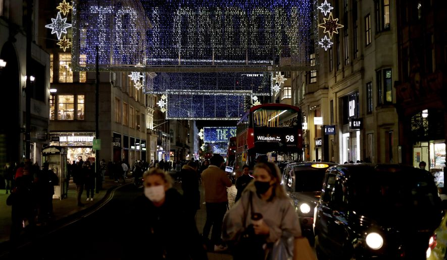 The Oxford Street Christmas lights stand lit up after being switched on today, in London, Monday, Nov. 2, 2020. British Prime Minister Boris Johnson on Saturday announced a new month-long lockdown for England that will start on Thursday, after being warned that without tough action a resurgent coronavirus outbreak will overwhelm hospitals in weeks. (AP Photo/Matt Dunham)