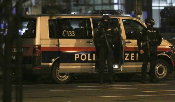Police officers stay in position during an operation, in Vienna, Austria, Tuesday, Nov. 3, 2020. Police in the Austrian capital said several shots were fired shortly after 8 p.m. local time on Tuesday, Nov. 2, in a lively street in the city center of Vienna and that there were six different shooting locations. Austria's top security official said authorities believe there were several gunmen involved and that a police operation was still ongoing. (Photo/Ronald Zak)