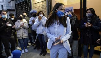 U.S. Rep. Alexandria Ocasio-Cortez, D-N.Y., speaks to members of her staff and volunteers who helped with her campaign and getting out the vote, Tuesday, Nov. 3, 2020, outside her office in the Bronx borough of New York. (AP Photo/Kathy Willens)