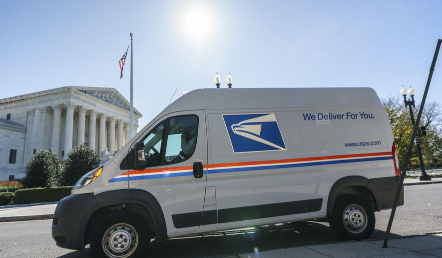 In this file photo, a U.S. Postal Service truck makes deliveries next to the Supreme Court on Election Day, Tuesday, Nov. 3, 2020, in Washington.  (AP Photo/J. Scott Applewhite) **FILE**