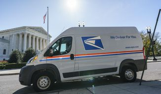 A U.S. Postal Service truck makes deliveries next to the Supreme Court on Election Day, Tuesday, Nov. 3, 2020, in Washington.  (AP Photo/J. Scott Applewhite) **FILE**