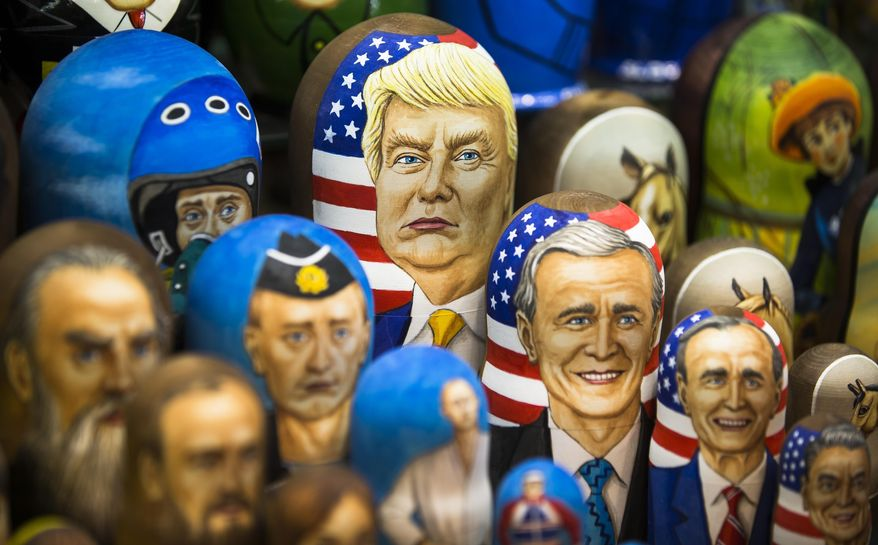 In this photo taken on Thursday, March 2, 2017, Matryoshkas, traditional Russian wooden dolls, including a doll of U.S. President Donald Trump, top, are displayed for sale in Moscow, Russia. From Moscow, the U.S. election looks like a contest between who dislikes Russia most, according to Kremlin spokesman Dmitry Peskov. Russian President Vladimir Putin is frustrated with President Donald Trump's failure to deliver on his promise to fix ties between the countries. But Democratic challenger Joe Biden does not offer the Kremlin much hope either. (AP Photo/Alexander Zemlianichenko, File)