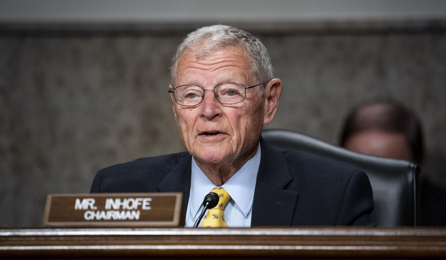 FILE - In this May 7, 2020 file photo, Senate Armed Services Chairman James Inhofe, R-Okla, questions Kenneth Braithwaite, nominated to be Secretary of the Navy, during a Senate Armed Services Committee hearing on Capitol Hill in Washington. The incumbent Republican is running for reelection. (Al Drago/Pool via AP, File)