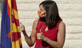 Arizona Republican Sen. Martha McSally gives a thumbs-up prior to speaking at Republican Party Headquarters, Monday, Nov. 2, 2020, in Phoenix. McSally is running against Democratic candidate Mark Kelly in the election set for Tuesday. (AP Photo/Ross D. Franklin)