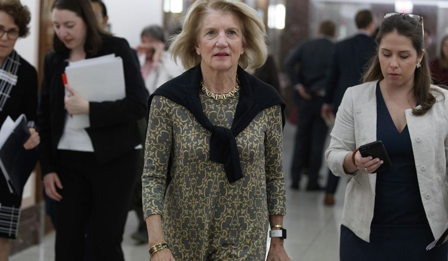 FILE - In this March 12, 2020, file photo, Sen. Shelley Moore Capito, R-W.Va., arrives for a briefing about the coronavirus outbreak on Capitol Hill in Washington. (AP Photo/Carolyn Kaster, File)