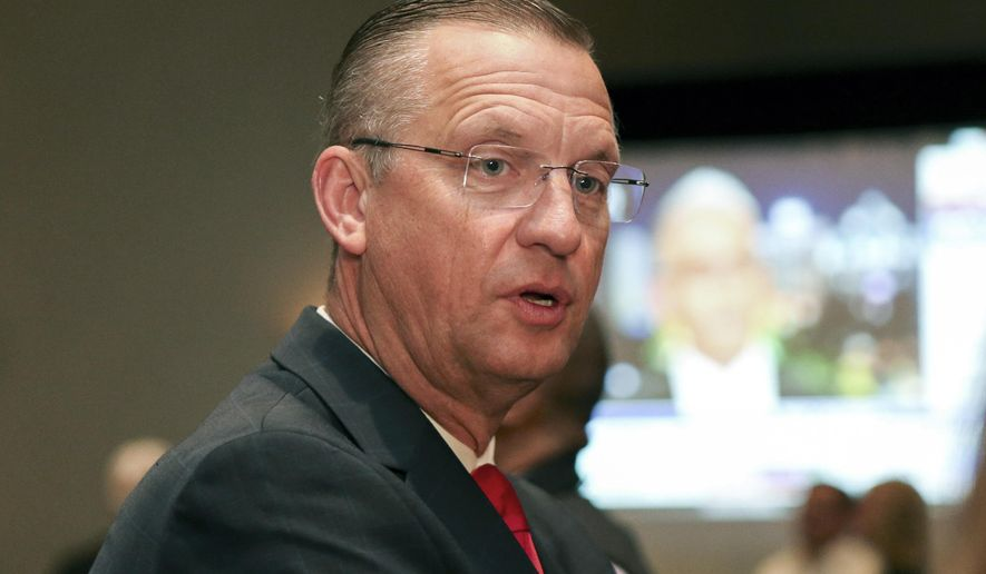 Republican candidate for Senate Rep. Doug Collins attends an election night watch party in Buford, Ga., Tuesday, Nov. 3, 2020. (AP Photo/Brett Davis)