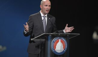 This photo taken Sept. 29, 2020, shows Utah Lt. Gov. Spencer Cox, a Republican, speaks while debating Democratic challenger Chris Peterson in Salt Lake City. Rival candidates vying to become Utah's next governor joined together in new ads Tuesday, Oct. 20, 2020, urging people to accept the results of the November elections and maintain decency with one another despite political differences.(Trent Nelson/The Salt Lake Tribune, via AP, Pool)