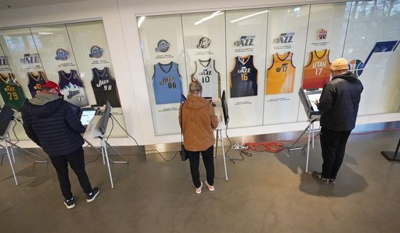 People vote at the Vivint Smart Home Arena, home of the NBA Jazz, Tuesday, Nov. 3, 2020, in Salt Lake City. (AP Photo/Rick Bowmer)