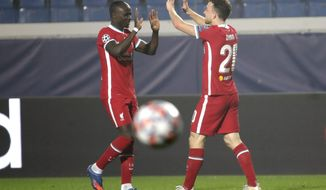 Liverpool's Sadio Mane, left, celebrates his goal with his teammate Liverpool's Diogo Jota against Atalanta during the Champions League, group D soccer match between Atalanta and Liverpool, at the Gewiss Stadium in Bergamo, Italy, Tuesday, Nov. 3, 2020. (AP Photo/Luca Bruno)