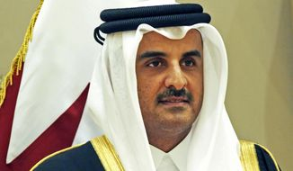 FILE - In this Tuesday, Dec. 5, 2017, file photo, Qatar's emir, Sheikh Tamim bin Hamad Al Thani stands for a group photograph at the Gulf Cooperation Council summit in Kuwait. Qatar's emir announced on Tuesday that the country will hold long-promised elections for its top advisory panel next year. (AP Photo/Jon Gambrell, File)
