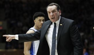 In this Saturday, March 7, 2020, file photo, Duke head coach Mike Krzyzewski reacts to an official during the second half of an NCAA college basketball game against North Carolina in Durham, N.C. The NCAA's announcement college basketball start date led to huge scramble as schools tried to fill out schedules altered by the coronavirus pandemic. (AP Photo/Gerry Broome, File) **FILE**