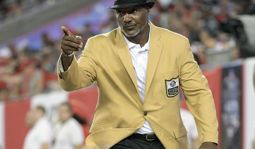 FILE - In this Oct. 5, 2017, file photo, former Tampa Bay Buccaneers and Hall of Fame linebacker Derrick Brooks walks behind the end zone during the first half of an NFL football game against the New England Patriots in Tampa, Fla. This has been a year for Tampa Bay sports like no other, though the area's three successful professional teams haven't had a chance to truly capitalize on the boom and connect with re-energized fan bases. Derrick Brooks says he feels for the fans not being able to go to the games and celebrate their teams victories and success.(AP Photo/Phelan M. Ebenhack, File)