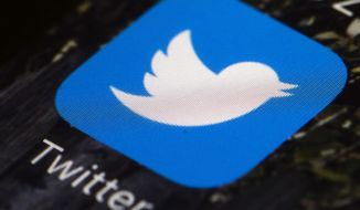 This April 26, 2017, file photo shows the Twitter app icon on a mobile phone in Philadelphia.  (AP Photo/Matt Rourke, File)