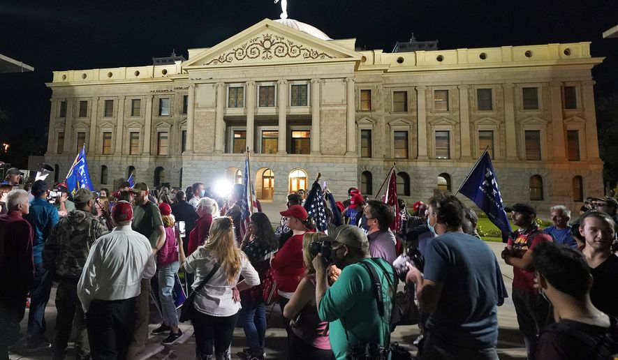 President Trump supporters gather for a voters rights rally, Wednesday, Nov. 4, 2020, at the Capitol in Phoenix. (AP Photo/Matt York)
