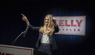 Sen. Kelly Loeffler, R-Ga., waves during a watch party on election night, Tuesday, Nov. 3, 2020, Atlanta. Loeffler will face Democrat Raphael Warnock in a Jan. 5 runoff. (Branden Camp/Atlanta Journal-Constitution via AP)
