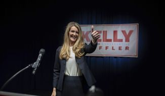 Sen. Kelly Loeffler, R-Ga., gestures during a watch party on election night, Tuesday, Nov. 3, 2020, Atlanta. Loeffler will face Democrat Raphael Warnock in a Jan. 5 runoff. (Branden Camp/Atlanta Journal-Constitution via AP)