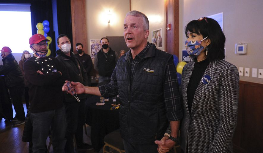 Sen. Dan Sullivan, R-Alaska, and his wife, Julie, speak to a crowd of supporters Tuesday, Nov. 3, 2020, in Anchorage, Alaska. (AP/Michael Dinneen)