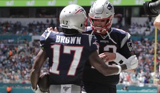FILE - In this Sept. 15, 2019, file photo, then-New England Patriots quarterback Tom Brady (12) and wide receiver Antonio Brown (17) celebrate after Brown scored a touchdown during the first half at an NFL football game against the Miami Dolphins, in Miami Gardens, Fla. Antonio Brown practices with the Tampa Bay Buccaneers for the first time, Wednesday, Nov. 4, 2020,  and is eager to take advantage of his latest opportunity to continue his NFL career. (AP Photo/Lynne Sladky, File)