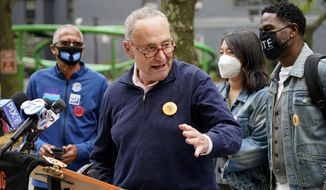 Sen. Chuck Schumer speaks at a news conference outside an early voting site in New York, Tuesday, Oct. 27, 2020. New Yorkers lined up to vote early for a fourth consecutive day Tuesday after a weekend that saw a crush of more than 400,000 voters statewide. The unofficial tally shows about 194,000 voters this weekend in New York City, where some people waited an hour or more in lines that stretched for several blocks. (AP Photo/Seth Wenig) ** FILE **