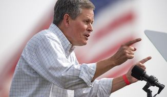 FILE - In this Sept. 14, 2020, file photo, Sen. Steve Daines, R-Mont., speaks at a campaign rally for his reelection bid in Belgrade, Mont. (AP Photo/Tommy Martino, File)