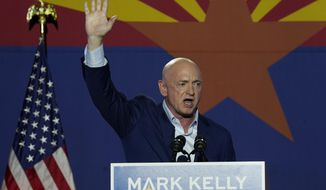 Mark Kelly, Arizona Democratic candidate for U.S. Senate, waves to supporters as he speaks during an election night event Tuesday, Nov. 3, 2020 in Tucson, Ariz. (AP Photo/Ross D. Franklin)