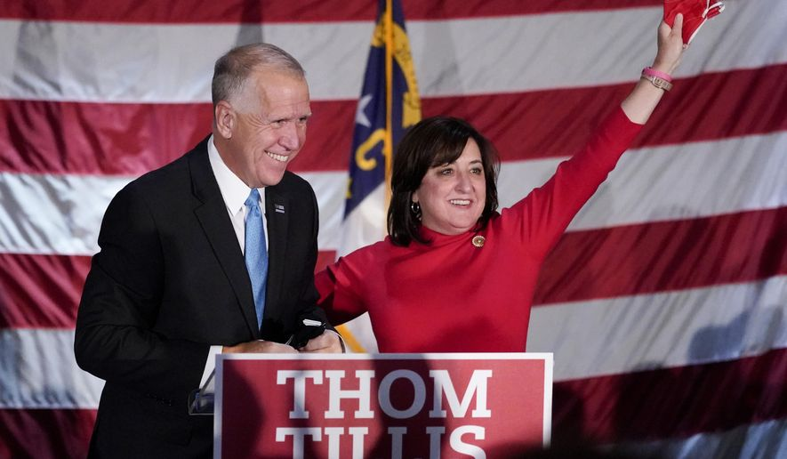 Sen. Thom Tillis, R-N.C., celebrates with his wife Susan, at a election night rally Tuesday, Nov. 3, 2020, in Mooresville, N.C. (AP Photo/Chris Carlson)