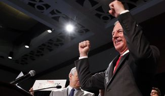 Republican Tommy Tuberville celebrates as he walks to the stage to speak to supporters after his win in the race for U.S. Senate, at his watch party Tuesday, Nov. 3, 2020, in Montgomery, Ala. (AP Photo/Butch Dill)
