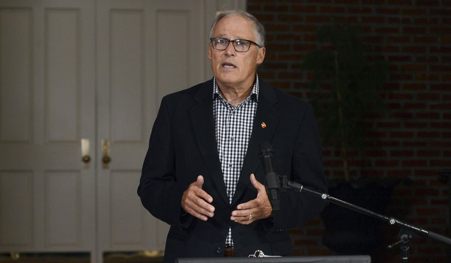 Gov. Jay Inslee thanks the voters of Washington state after winning his third term, Tuesday, Nov. 3, 2020, in Olympia Wash. (Steve Bloom/The Olympian via AP) ** FILE **
