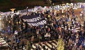 People gather in Black Lives Matter Plaza near White House in Washington, Tuesday, Nov. 3, 2020, on Election Day. (AP Photo/Susan Walsh)